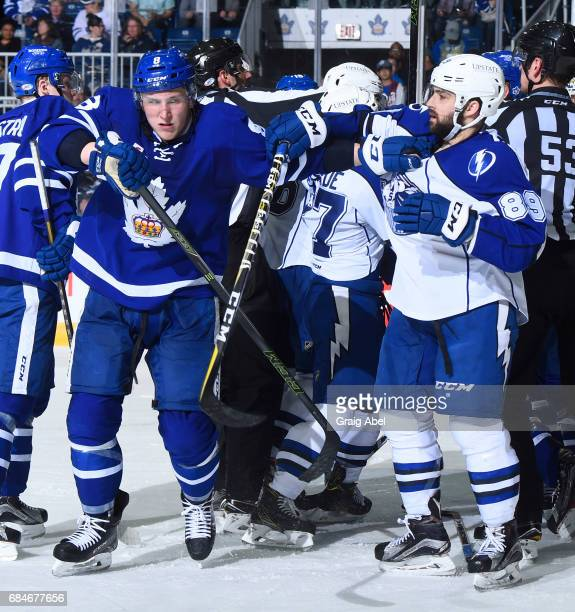 Travis Dermott of the Toronto Marlies mixes it up with Cory Conacher of the Syracuse Crunch during game 6 action in the Division Final of the Calder...