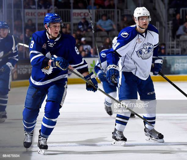 Travis Dermott of the Toronto Marlies watches the play develop against Byron Froese of the Syracuse Crunch during game 6 action in the Division Final...