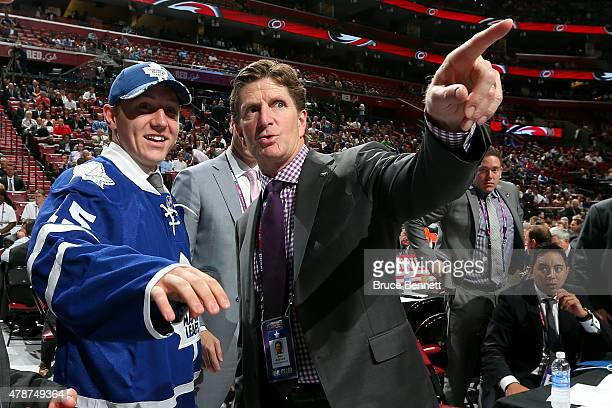 Travis Dermott talks with head coach Mike Babcock after being selected 34th by the of the Toronto Maple Leafs during the 2015 NHL Draft at BBT Center...