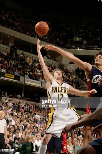 Travis Diener of the Indiana Pacers shoots over Anderson Varejao of the Cleveland Cavaliers at Conseco Fieldhouse on February 10 2009 in Indianapolis...