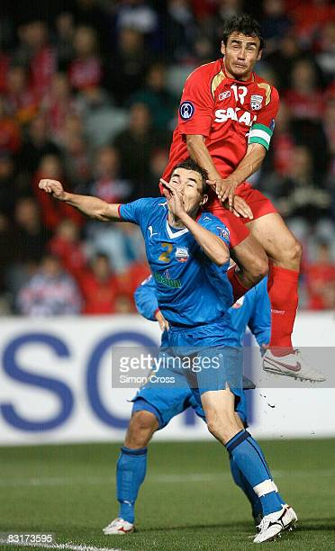 Travis Dodd of United jumps over Bakhtiyor Ashurmatov of Bunyodkor to set up Giuseppe Barbiero's goal during the AFC Champions League semifinal first...