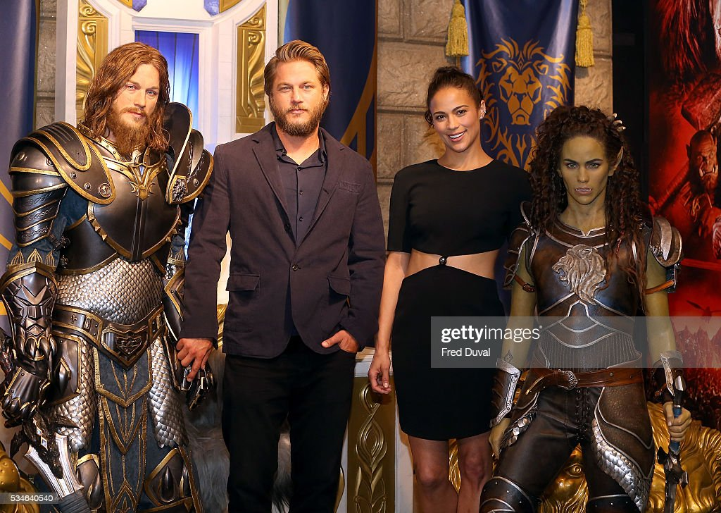 <a gi-track='captionPersonalityLinkClicked' href=/galleries/search?phrase=Travis+Fimmel&family=editorial&specificpeople=3144066 ng-click='$event.stopPropagation()'>Travis Fimmel</a> and <a gi-track='captionPersonalityLinkClicked' href=/galleries/search?phrase=Paula+Patton&family=editorial&specificpeople=752812 ng-click='$event.stopPropagation()'>Paula Patton</a> attend the launch of the Warcraft Experience at Madame Tussauds on May 27, 2016 in London, England.
