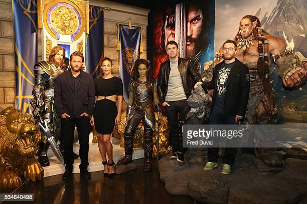 Travis Fimmel Paula Patton Toby Kebbell and Duncan Jones attend the launch of the Warcraft Experience at Madame Tussauds on May 27 2016 in London...