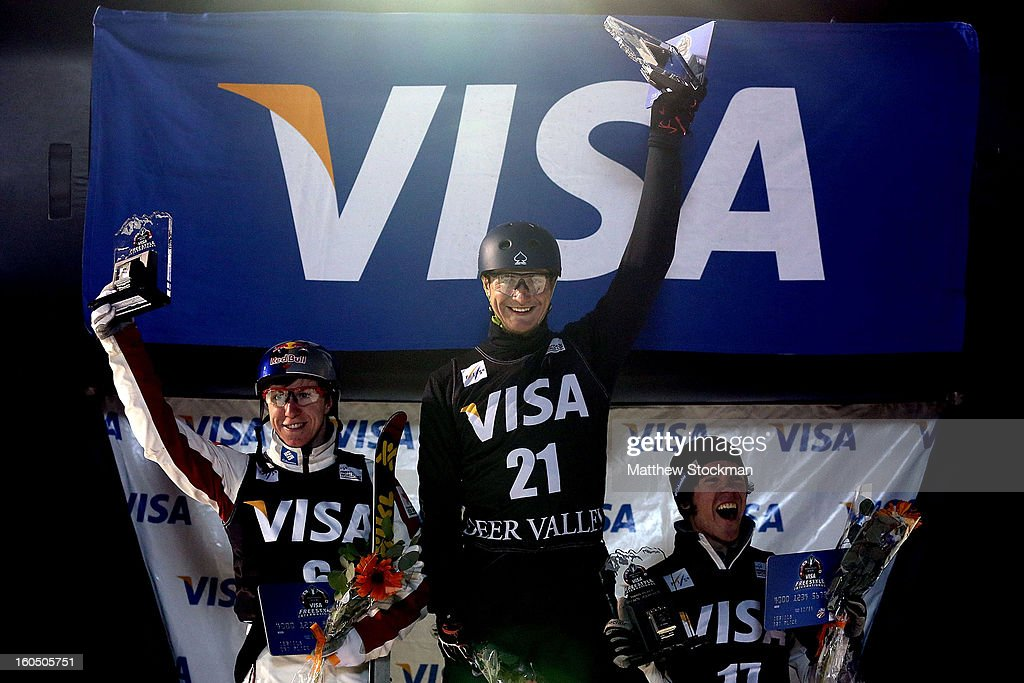 Travis Gerrits #6 of Canada in second place, Maxim Gustik #21 of Belarus in first place and Michael Rossi #17 in third place stand on the medals podium after the Men's Aerials during the Visa Freestyle International at Deer Valley on February 1, 2013 in Park City, Utah.