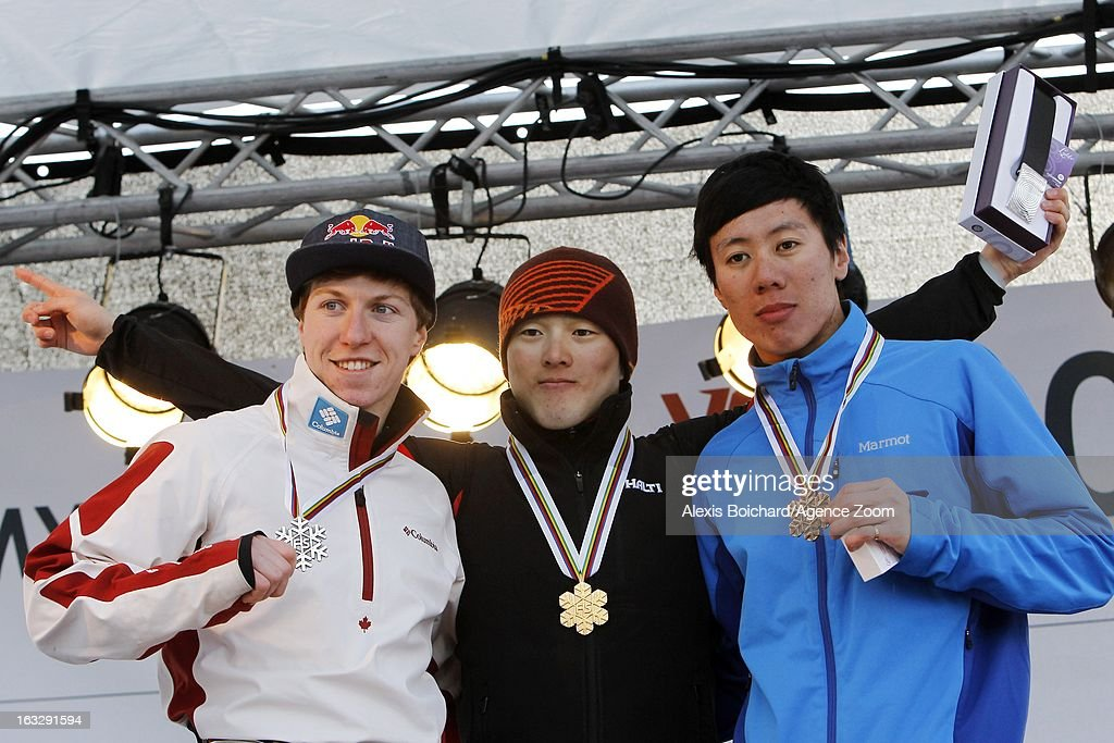 Travis Gerrits of Canada takes 2nd place, Travis Guangpu Qi of China takes 1st place and Zongyang Jia of China takes 3rd place during the FIS Freestyle Ski World Championship Men's and Women's Aerials on March 07, 2013 in Voss, Norway.