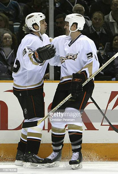 Travis Green and Joe DiPenta of the Anaheim Ducks celebrate after scoring against the San Jose Sharks during the NHL game held at the HP Pavilion...