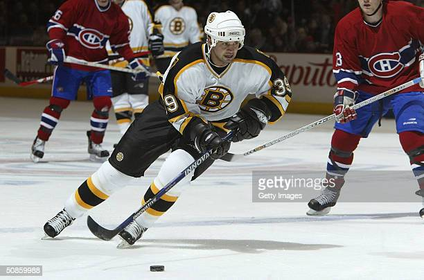 Travis Green of the Boston Bruins carries the puck into the offensive zone during game three of the 2004 NHL Eastern Conference Quarterfinals against...