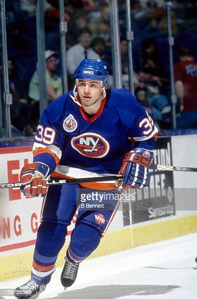 Travis Green of the New York Islanders skates on the ice during an NHL game in April 1993