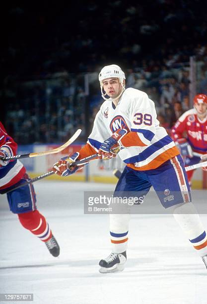 Travis Green of the New York Islanders skates on the ice during an NHL game against the Washington Capitals on January 14 1993 at the Nassau Coliseum...
