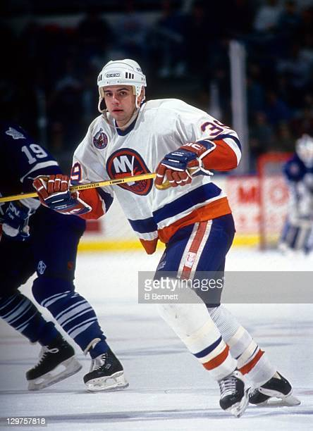 Travis Green of the New York Islanders skates on the ice during an NHL game against the Toronto Maple Leafs on December 29 1992 at the Nassau...
