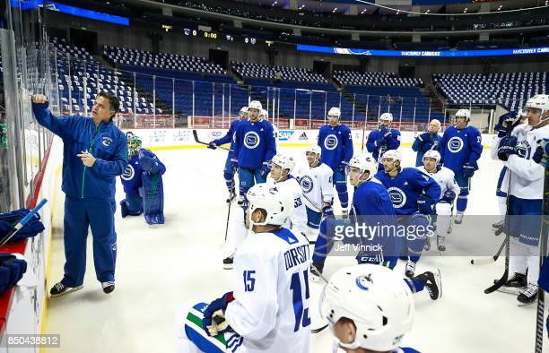 Travis Green of the Vancouver Canucks explains a drill during their gameday skate at MercedesBenz Arena September 21 2017 in Shanghai China The...