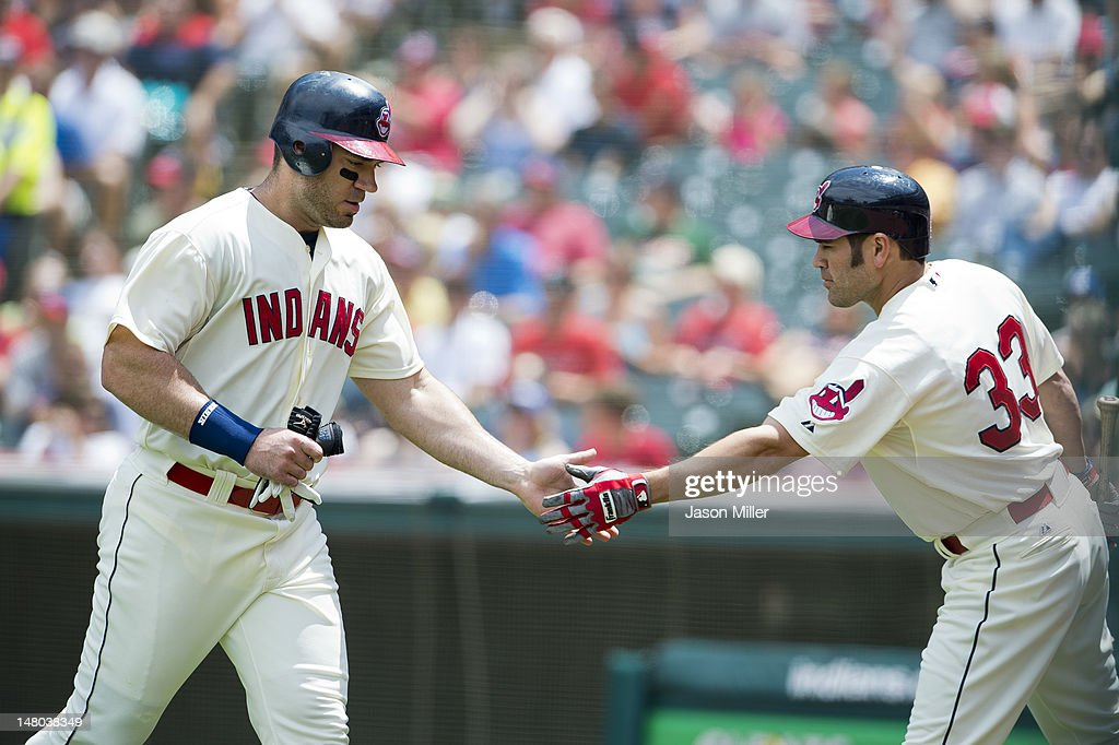 Travis Hafner #48 of the Cleveland Indians (L) celebrates with Johnny Damon #33 after Hafner scored on a single by Casey Kotchman #35 during the second inning against the Tampa Bay Rays at Progressive Field on July 8, 2012 in Cleveland, Ohio.