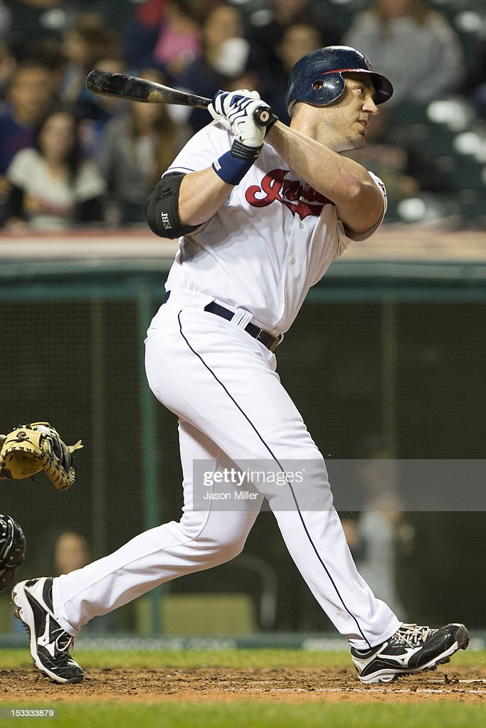Travis Hafner of the Cleveland Indians hits a single during the seventh inning against the Chicago White Sox at Progressive Field on October 3 2012...