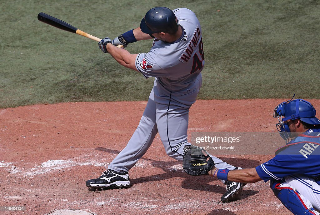 Travis Hafner #48 of the Cleveland Indians hits an RBI single in the 8th inning during MLB game action against the Toronto Blue Jays on July 14, 2012 at Rogers Centre in Toronto, Ontario, Canada.