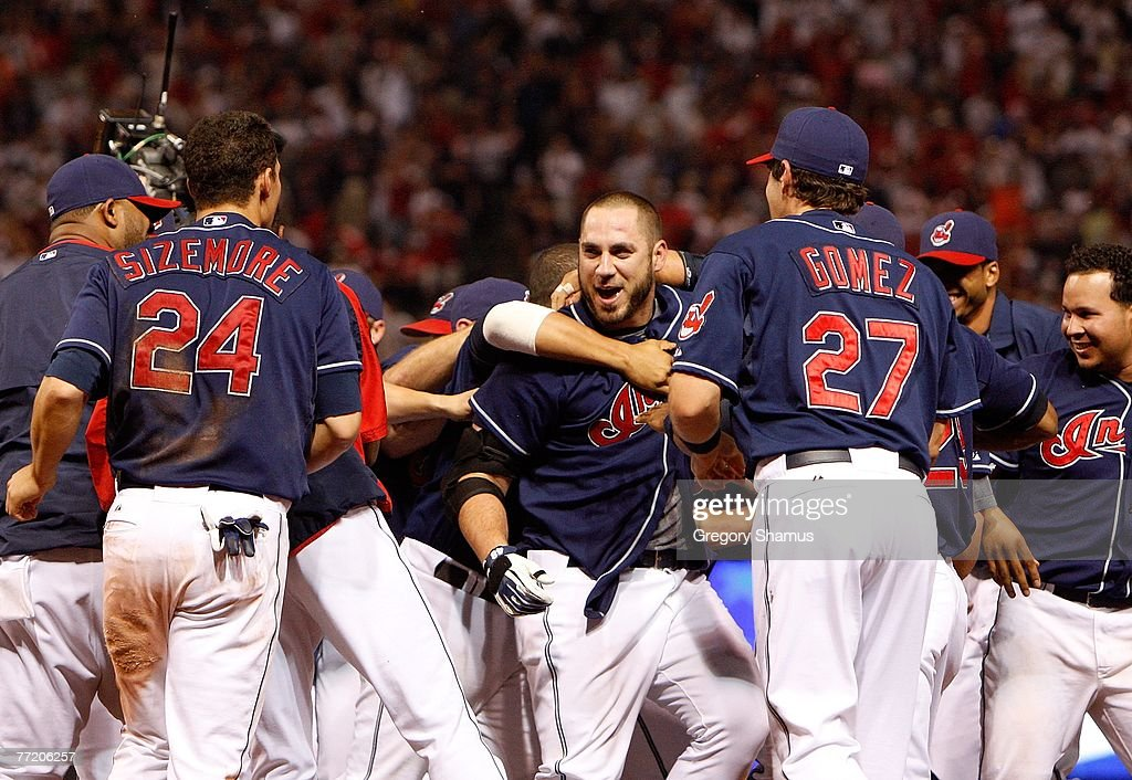 Travis Hafner #48 (C - facing camera) of the Cleveland Indians is swarmed by teammates after Hafner hit a game-winning RBI single to score Kenny Lofton in the bottom of the eleventh inning against the New York Yankees during Game Two of the American League Divisional Series at Jacobs Field on October 5, 2007 in Cleveland, Ohio.