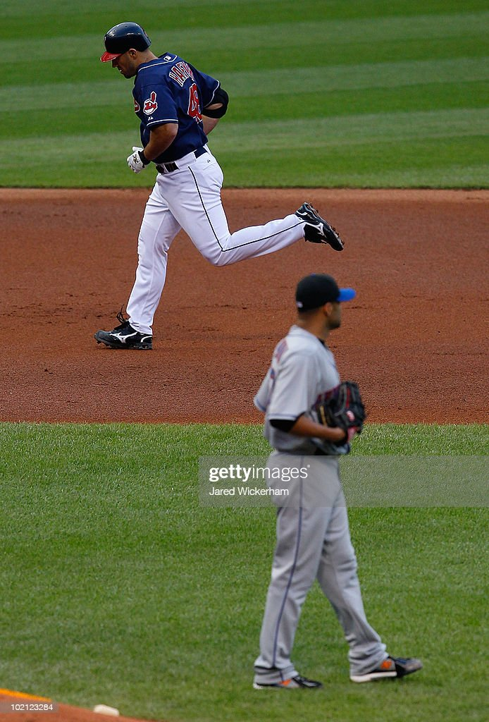 Travis Hafner of the Cleveland Indians rounds the bases after hitting a home run off of Johan Santa of the New York Mets during the game on June 15...