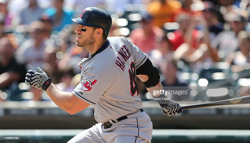 Travis Hafner of the Cleveland Indians singles to left field scoring Carlos Santana in the seventh inning during the game against the Detroit Tigers...