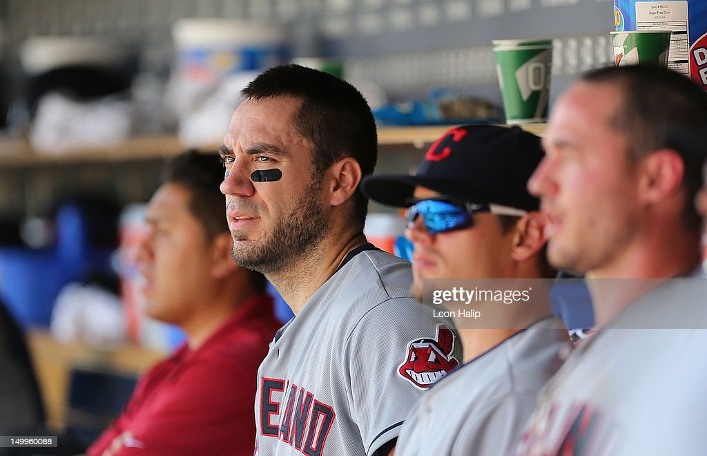 Travis Hafner #48 of the Cleveland Indians watches the action from the dugout during the game against the Detroit Tigers at Comerica Park on August 5, 2012 in Detroit, Michigan. The Tigers defeated the Indians 10-8 in ten innings.