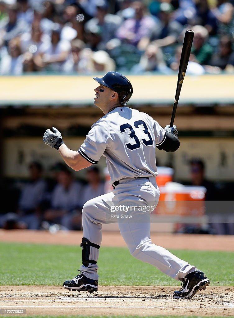 <a gi-track='captionPersonalityLinkClicked' href=/galleries/search?phrase=Travis+Hafner&family=editorial&specificpeople=220556 ng-click='$event.stopPropagation()'>Travis Hafner</a> #33 of the New York Yankees bats against the Oakland Athletics at O.co Coliseum on June 13, 2013 in Oakland, California.