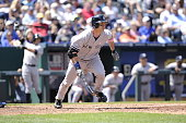 Travis Hafner of the New York Yankees bats and runs to first base from the batter's box in the game against the Kansas City Royals on May 12 2013 at...