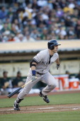 Travis Hafner of the New York Yankees bats during the game against the Oakland Athletics at Oco Coliseum on June 12 2013 in Oakland California The...
