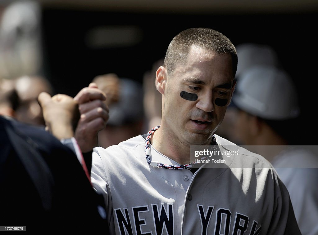 <a gi-track='captionPersonalityLinkClicked' href=/galleries/search?phrase=Travis+Hafner&family=editorial&specificpeople=220556 ng-click='$event.stopPropagation()'>Travis Hafner</a> #33 of the New York Yankees celebrates scoring against the Minnesota Twins during the first inning of the game on July 4, 2013 at Target Field in Minneapolis, Minnesota. The Yankees defeated the Twins 9-5.