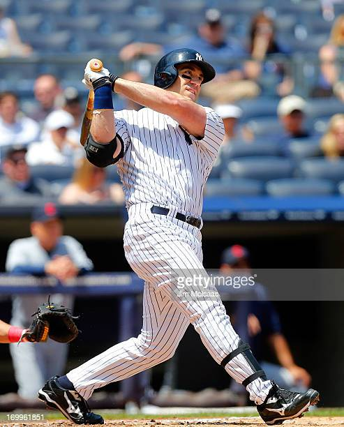 Travis Hafner of the New York Yankees follows through on a first inning two run home run against the Cleveland Indians at Yankee Stadium on June 5...