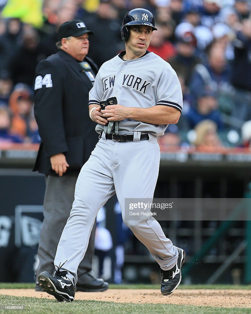 <a gi-track='captionPersonalityLinkClicked' href=/galleries/search?phrase=Travis+Hafner&family=editorial&specificpeople=220556 ng-click='$event.stopPropagation()'>Travis Hafner</a> #33 of the New York Yankees scores a run against the Detroit Tigers at Comerica Park on April 6, 2013 in Detroit, Michigan.