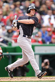 Travis Hafner of the New York Yankees takes a swing during an exhibition baseball game against the Washington Nationals on March 29 2013 at Nationals...