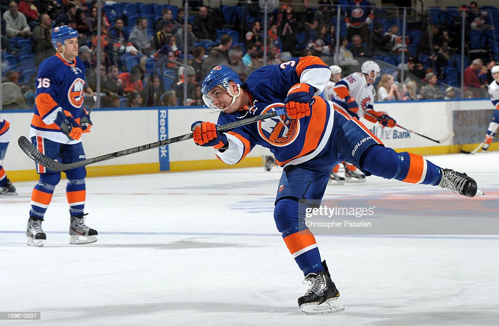 Travis Hamonic #3 of Team Blue skates prior to a scrimmage match between players of the New York Islanders and Bridgeport Sound Tigers on January 16, 2013 at Nassau Veterans Memorial Coliseum in Uniondale, New York.