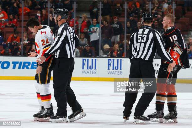 Travis Hamonic of the Calgary Flames and Corey Perry of the Anaheim Ducks get separated following a fight during the game on October 9 2017 at Honda...