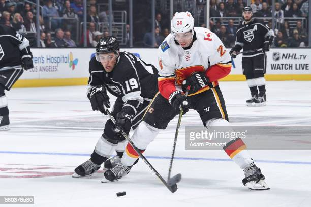 Travis Hamonic of the Calgary Flames battles for the puck against Alex Iafallo of the Los Angeles Kings at STAPLES Center on October 11 2017 in Los...