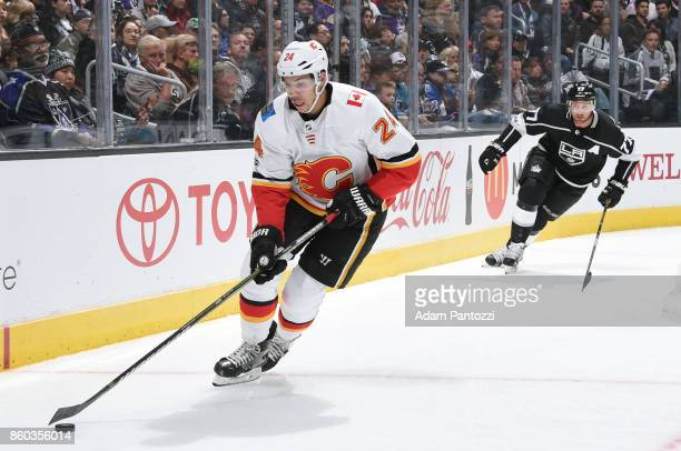 Travis Hamonic of the Calgary Flames handles the puck during a game against the Los Angeles Kings at STAPLES Center on October 11 2017 in Los Angeles...
