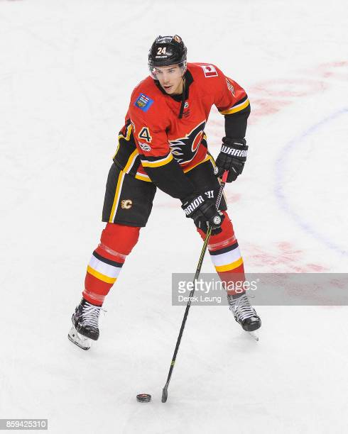 Travis Hamonic of the Calgary Flames in action against the Winnipeg Jets during an NHL game at Scotiabank Saddledome on October 7 2017 in Calgary...