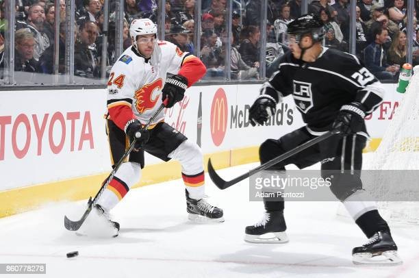Travis Hamonic of the Calgary Flames passes the puck during a game against the Los Angeles Kings at STAPLES Center on October 11 2017 in Los Angeles...