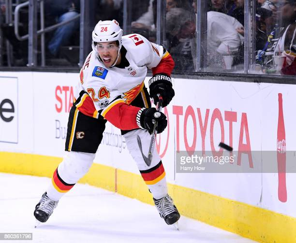 Travis Hamonic of the Calgary Flames shoots the puck aroung the boards during the second period against the Los Angeles Kings at Staples Center on...