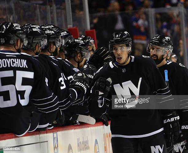 Travis Hamonic of the New York Islanders celebrates a first period goal against the Montreal Canadiens at the Barclays Center on November 20 2015 in...