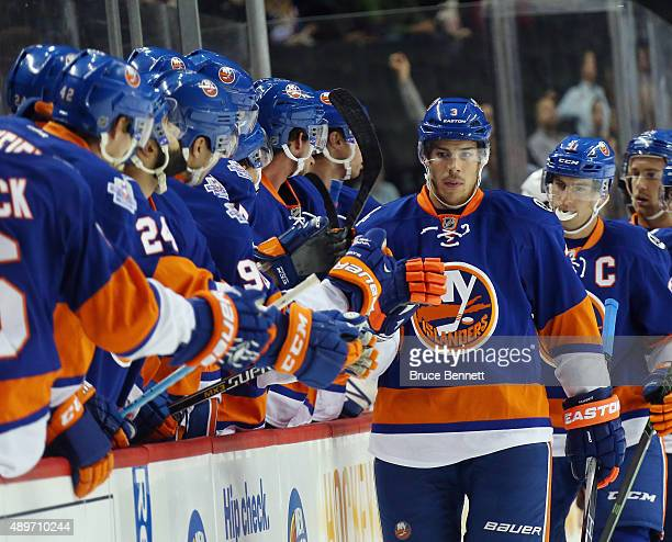 Travis Hamonic of the New York Islanders celebrates his first period goal against the New Jersey Devils at the Barclays Center on September 23 2015...
