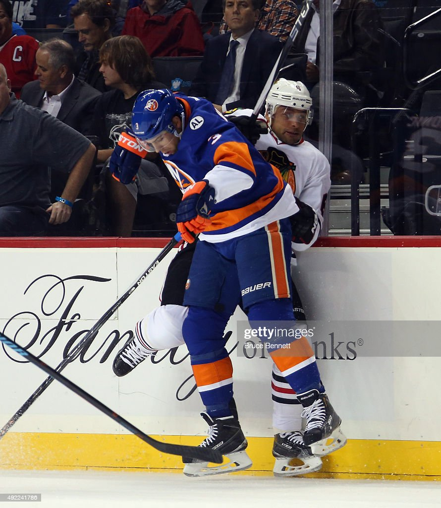 Travis Hamonic #3 of the New York Islanders hits Trevor Daley #6 of the Chicago Blackhawks at the Barclays Center on October 9, 2015 in Brooklyn borough of New York City. The game is the first for the Islanders in their new arena. The Blackhawks defeated the Islanders 3-2 in overtime.