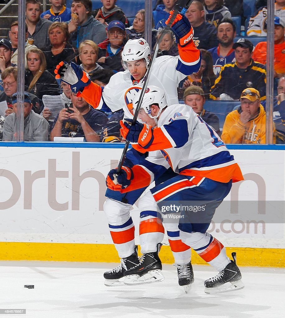 <a gi-track='captionPersonalityLinkClicked' href=/galleries/search?phrase=Travis+Hamonic&family=editorial&specificpeople=4605791 ng-click='$event.stopPropagation()'>Travis Hamonic</a> #3 of the New York Islanders jumps to avoid teammate Thomas Hickey #14 in their game against the Buffalo Sabres on April 13, 2014 at the First Niagara Center in Buffalo, New York. New York won, 4-3.