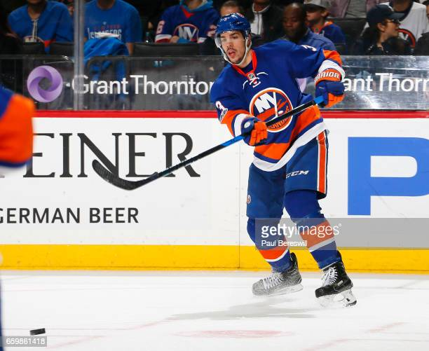 Travis Hamonic of the New York Islanders passes in an NHL hockey game against the Boston Bruins at the Barclays Center on March 25 2017 in the...