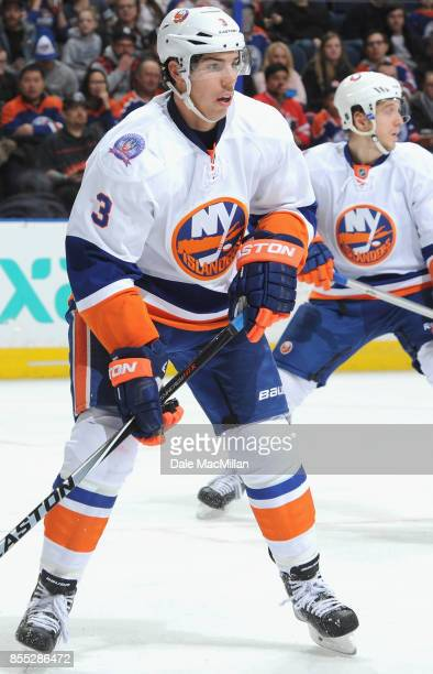 Travis Hamonic of the New York Islanders plays in a game against the Edmonton Oilers at Rexall Place on January 4 2015 in Edmonton Alberta Canada