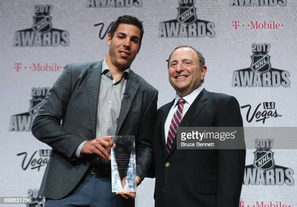 Travis Hamonic of the New York Islanders poses with NHL commissioner Gary Bettman after receiving the NHL Foundation Player Award during the 2017 NHL...