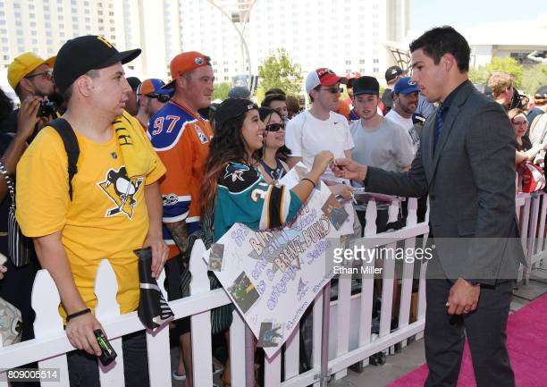 Travis Hamonic of the New York Islanders signs autographs as he attends the 2017 NHL Awards at TMobile Arena on June 21 2017 in Las Vegas Nevada