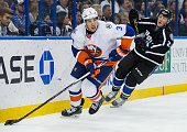 Travis Hamonic of the New York Islanders skates against Erik Condra of the Tampa Bay Lightning during the game at Amalie Arena on November 28 2015 in...