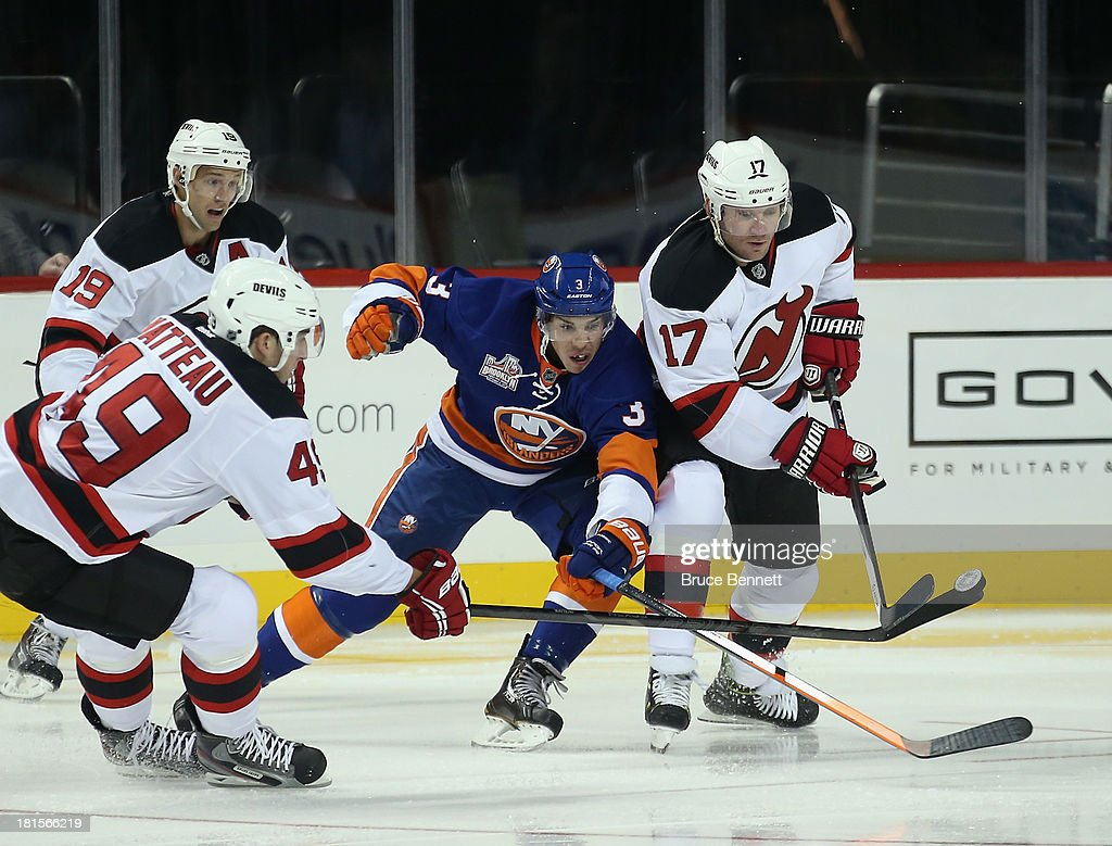 <a gi-track='captionPersonalityLinkClicked' href=/galleries/search?phrase=Travis+Hamonic&family=editorial&specificpeople=4605791 ng-click='$event.stopPropagation()'>Travis Hamonic</a> #3 of the New York Islanders skates against the New Jersey Devils during a preseason game at the Barclays Center on September 21, 2013 in Brooklyn borough of New York City.The game is the first professional hockey match to be held in the arena that is slated to be the new home for the Islanders at the start of the 2015-2016 season. The Devils defeated the Islanders 3-0.