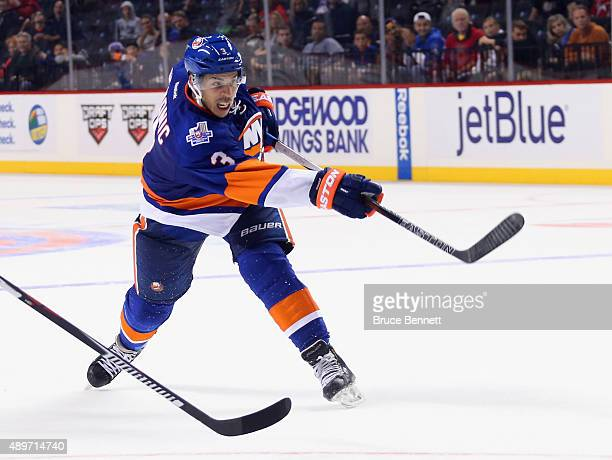Travis Hamonic of the New York Islanders skates against the New Jersey Devils at the Barclays Center on September 23 2015 in the Brooklyn borough of...