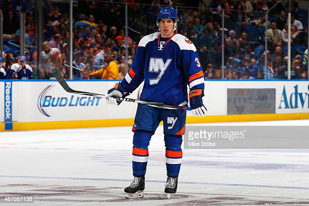 Travis Hamonic of the New York Islanders skates against the San Jose Sharks at Nassau Veterans Memorial Coliseum on October 16 2014 in Uniondale New...