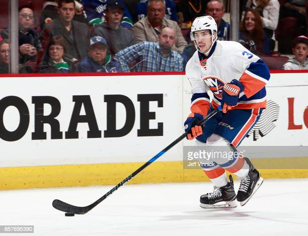 Travis Hamonic of the New York Islanders skates up ice with the puck during their NHL game against the Vancouver Canucks at Rogers Arena March 9 2017...