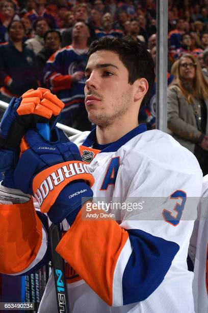 Travis Hamonic of the New York Islanders stands for the singing of the national anthem prior to the game agains the Edmonton Oilers on March 7 2017...